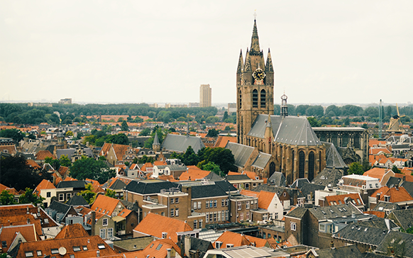 View of church spire in Delft with time